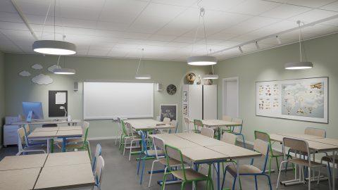 Klassrum med strömskena, pendlade armaturer och spotlights mot väggar.